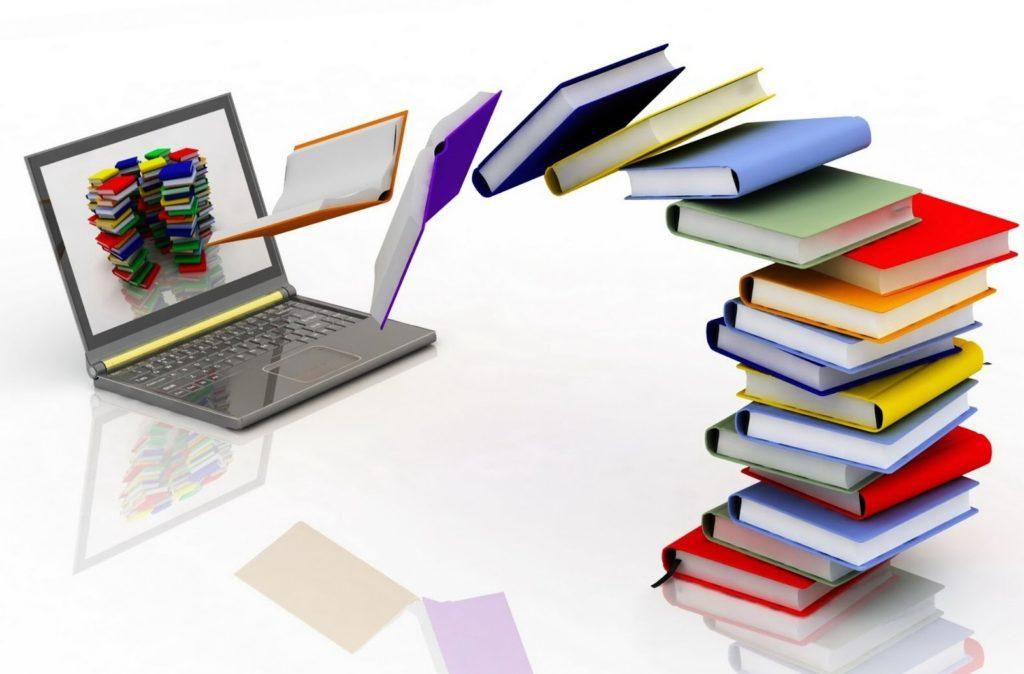 dei libri colorati entrano virtulalmente dentro un computer alla maker faire di roma