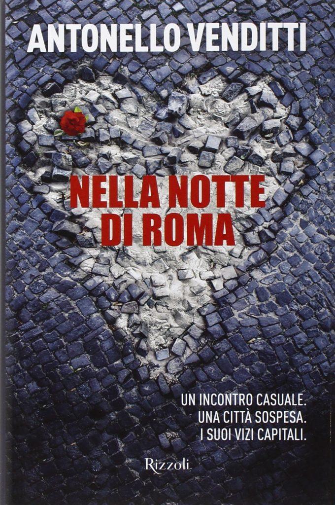 Nella notte di Roma di Antonello Venditti la copertina del libro su sfondo di ciottoli grigi un cuore bianco con il titolo al centro