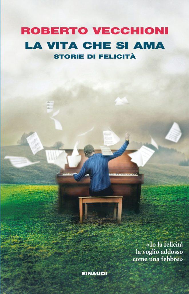 Roberto Vecchioni La vita che si ama la copertina del libro con un ragazzo seduo di schiena ad