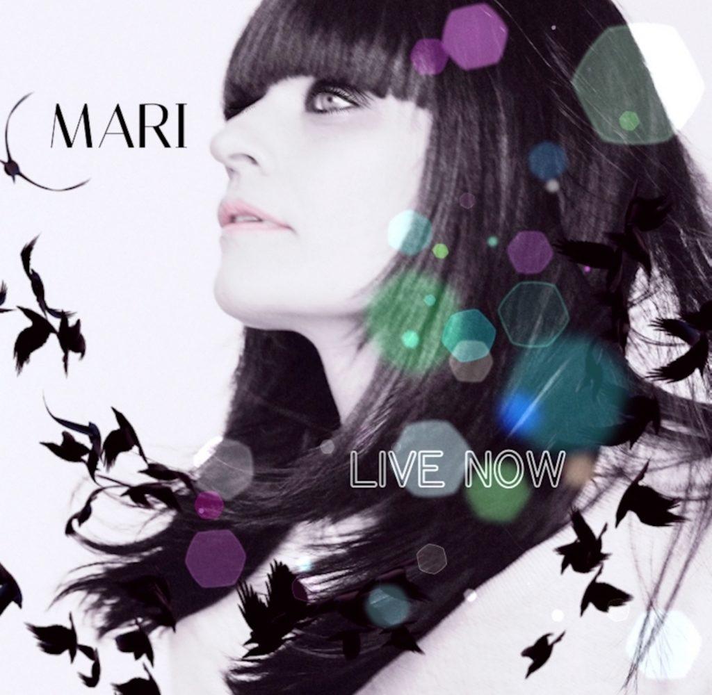 live now mari conti - la copertina del nuovo singolo che ritrae l cantante di profilo, capelli neri e lunghi, su sfondo bianco