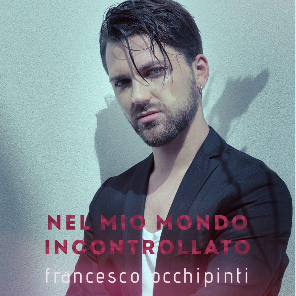 nel mio mondo incontrollato -  la copertina del singolo che ritrae francesco occhipinti in primo piano, capelli scuri, barba e giacca nera