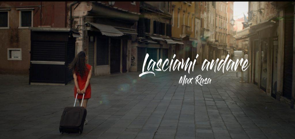 lasciami andare - la copertina del singolo che ritrae una donna di spalle, vestita di rosso, con un trolley, a passeggio per le vie di venezia